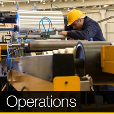 An image of a person working with machinery that links to our operations page